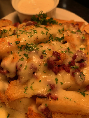 The Showdown Potato w Smokey Bacon, Melted Cheese, Ranch Dressing